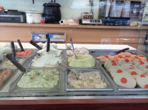 The appetizing counter at Korn's is a riot of pastels.